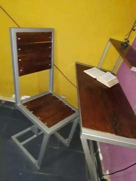 Escritorios y silla tipo industrial con amortiguador