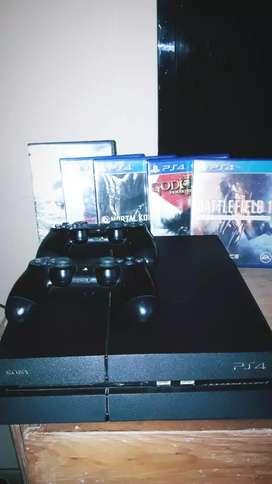Play 4 + 2 joystick + 5 juegos