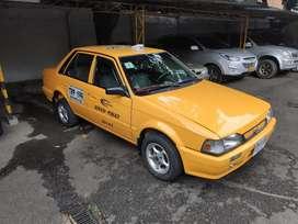 Taxi Mazda 323