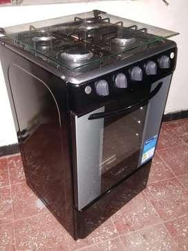 Vendo estufa marca haceb con encendido eléctrico tapa de vidrio y horno gratinador e
