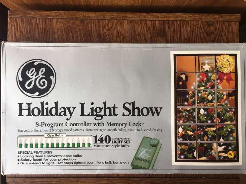 Extensión de 140 luces de Navidad con controlador marca General Electric