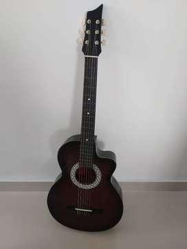 Guitarra acustica sin uso, como nueva