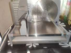 Máquina cortadora de carne, embutidos, horneados, perniles, lomos, etc.