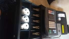El Ibagué vendo caja registradora doble rollo escribe el nombre de los productos y del negocio