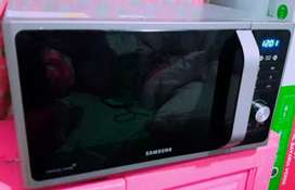 Por motivos de viaje pongo a la venta hermoso  horno microondas Samsung