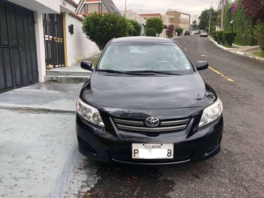 Toyota Corolla 1.6, 5 Puertas (2009), 150.000 kms de Recorrido Color Negro, Placa de Pichincha Terminada en 8 0