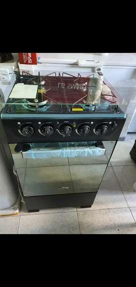 Estufas haceb nuevas  con gratinador encendido y tapa