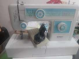 Se vende espectacular máquina de coser gemsy gem811atf