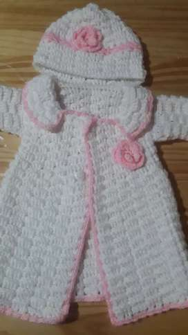 Saco tejido sin uso son gorro para nena.