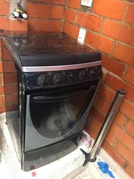 Vendo estufa horno como nueva