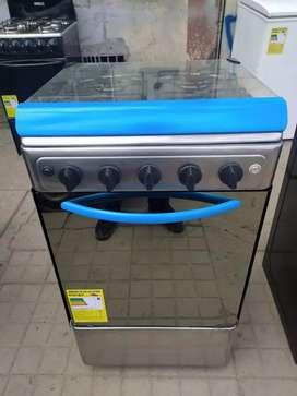 Vendo hermosa estufa marca haceb con Vidrio espejo