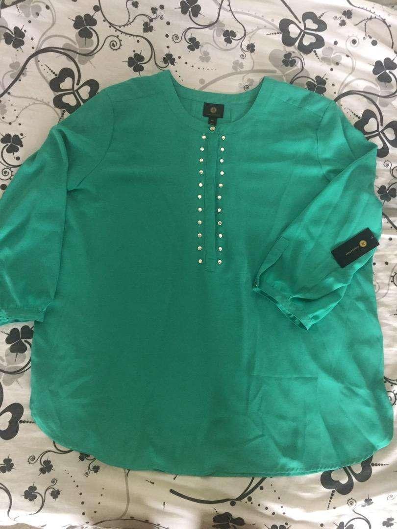 Blusa americana nueva color turquesa talla XXL 0