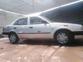 Vendo auto toyota corolla año 99 caja mecanica gasolinero timon original lito para la venta