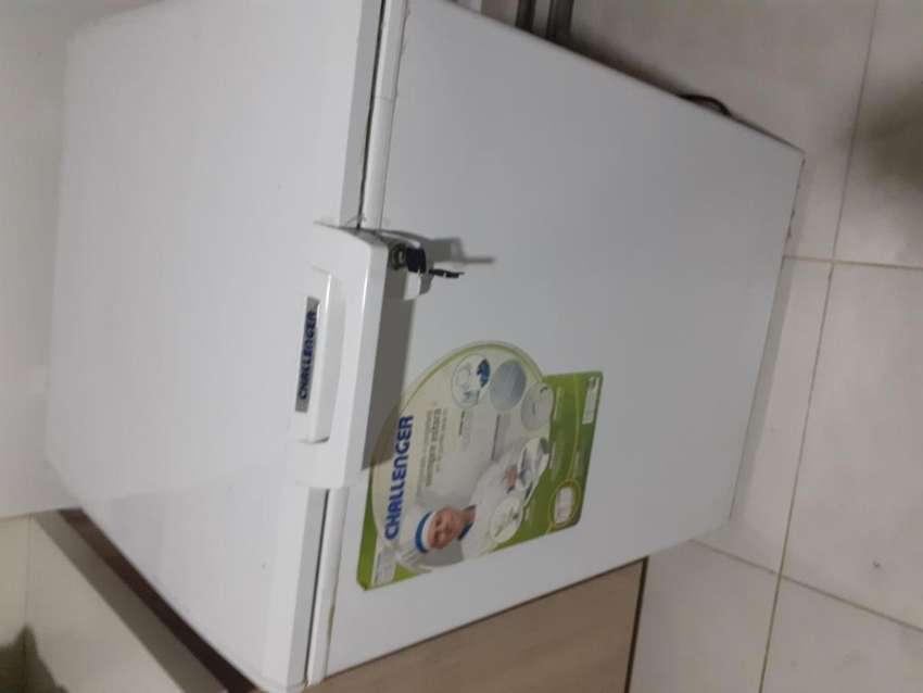 Se vende refrijerador congelador 0