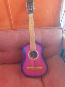 Guitarra Violeta y rosada nueva