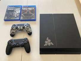 Playstation 4 + 2 joysticks + 2 juegos fisicos