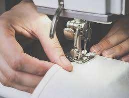 Operarios maquinas confeccion tejido de punto
