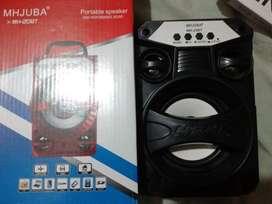 Parlante Bluetooth Portatil + SD 8GB LLENA DE MUSICA MH-23BT MHJUBA100