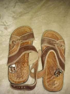 vdo sandalias Cuero