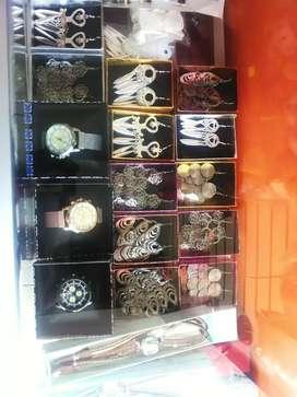 venta de relojes collares carteras y mochilas