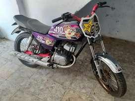 Vendo o permuto linda moto ax 100