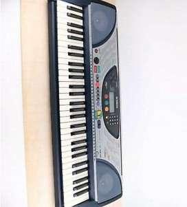 Vendo piano teclado NEGOCIABLE organeta