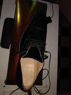 Vendo Zapatos de color negros,Talle 41. Perfecto estado