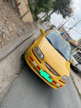 Taxi amarillo en venta con placa