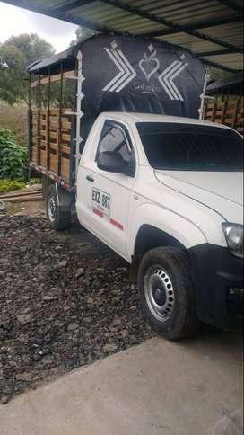 camioneta volkswagen amarok estacas . 4*4, eleva vidrios y espejos eléctricos aire acondicionado excelente estado.