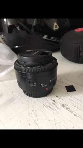 Canon t3 usada con objetivo kit mas youngnuo 35mm