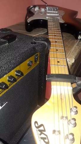 Guitarra skp más equipo marca RRozzi de 15w