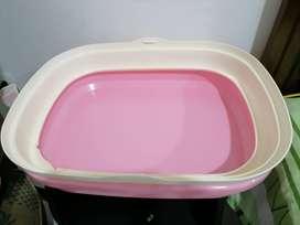 Arenero para gatita, color rosa.