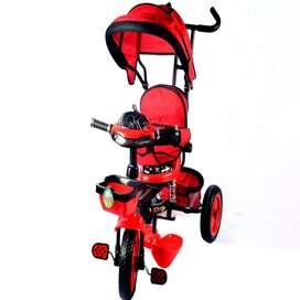 Triciclo paseadores color azul y rojo