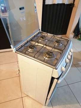 Vendo o cambio cocina DUREX a gas 4 HORNILLAS, puedo cambiar con bicicleta