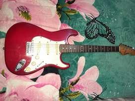 Vendo guitarra eléctrica en perfecto estado 10/10  nunca se la utilizo