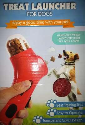 Lanzador de golosinas para mascotas  ,perros gatos etc