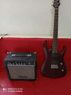 Vendo guitarra eléctrica con amplificador boston