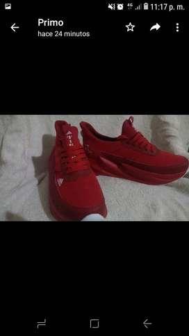 Vendo zapatos deportivos color rojo marca addidas talla 42