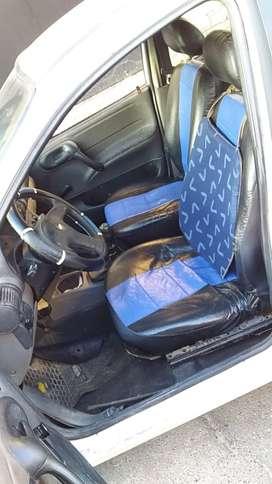 Vendo Chevrolet Corsa 2013 con licencia de taxis capital .