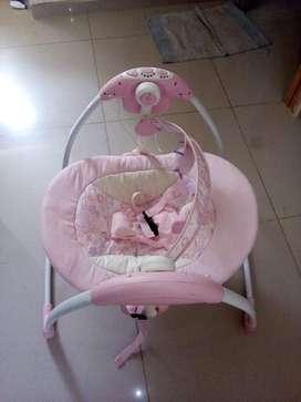 Mecedor musical para bebe