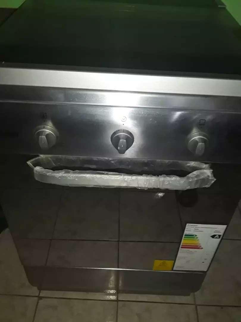 Se vende una cosina d inducción d horno 0