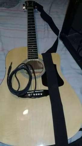 Dueña Vende guitarra y de regalo amplificador