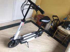 Scooter portatil Tomini