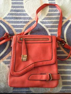 Linda cartera color coral