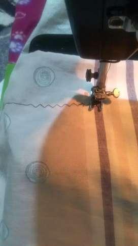 Vendo maquina de coser singer