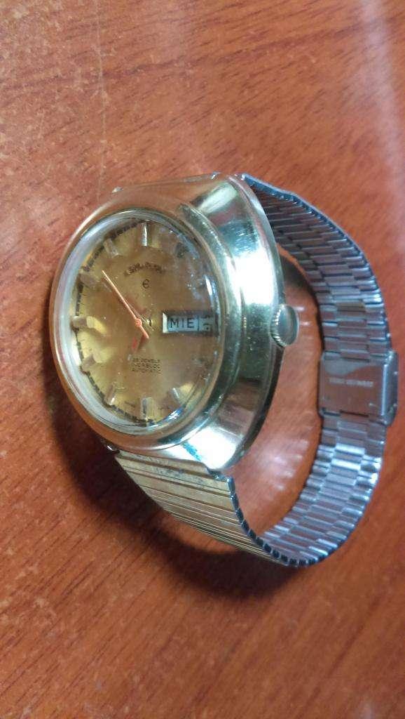 vendo cambio   clasico reloj  LOR ELGIN  SUIZO  automatico .,