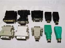 Adaptadores variados para computadora con salidas HDMI, MINI HDMI, VGA, S-video etc