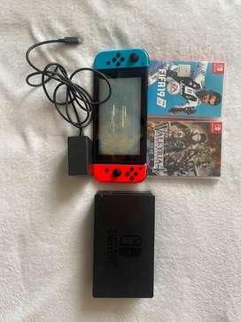 Nintendo switch, joy con, dock, cargador y 2 jurgos, tal cual esta en las fotos