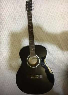 Guitarra acústica marca storm en perfecto estado