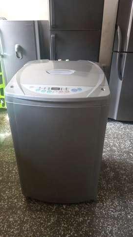 Vendo lavadora de 24 lb lg turbo drum con tres meses de garantia